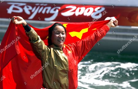 Yin Jian of China Celebrates Her Gold Medal Giving China Its First Ever Olympic Sailing Gold in the Womens Rs:x Women's Windsurfing Event in Qingdao China 20 August 2008 Italys Alessandra Sensini Won the Silver Medal and Bryony Shaw of Great Britain Won Bronze