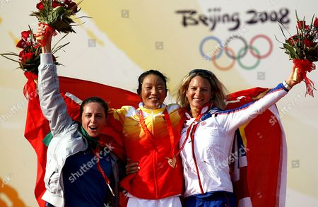 (l-r) Italys Alessandra Sensini with Silver Yin Jian of China with Gold and Bryony Shaw of Great Britain with Bronze at the Medal Ceremony For the Rs:x Women's Windsurfing Event in Qingdao China 20 August 2008 Yin Jian's Gold Medal Gives China Its First Ever Olympic Sailing Gold