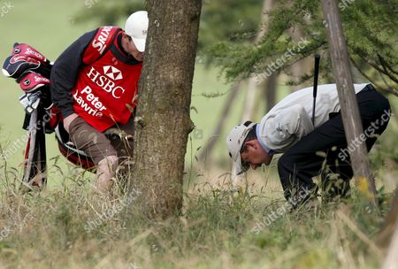 Peter Lawrie of Ireland Searches For His Ball During the 3rd Round of the Hsbc Champion Tournament in Shanghai China 09 November 2008 Oliver Wilson of England Currently Leads the Field a Score of 12 Under Par As Players Will Play an Extra Nine Holes of Golf Due to Previous Rain Cancellations