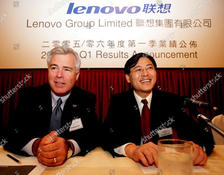Steve Ward (l) Chief Executive of Lenovo and Chairman Yuanqing Yang (r) Speak to the Media During a Lenovo Press Conference at the Conrad Hotel in Hong Kong Wednesday 10 August 2005 China's Largest Computer Maker Lenovo Said 10 August Its First Quarter Profits Saw Steady Growth Thanks to Sales of Mobile Phones and Contributions From Its Recently Acquired Ibm Personal Computer Unit