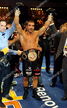 Germany's Firat Arslan Celebrates Winning the Wba Cruiserweight Title After He Beat Title Holder Virgil Hill of the Usa in Thier Wba Cruiserweight Title Boxing Fight at the Freiberger Arena in Dresden Germany 24 November 2007 Firat Arslan the Turkish-born German Won with Unanimous Decision with Scores of 118-110 116-113 and 117-111