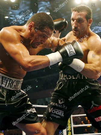 Germany's Firat Arslan (r) Lands a Blow On Title Holder Virgil Hill (l) of the Usa During Thier Wba Cruiserweight Title Boxing Fight at the Freiberger Arena in Dresden Germany 24 November 2007 Firat Arslan the Turkish-born German Won the Wba Cruiserweight Title with Unanimous Decision with Scores of 118-110 116-113 and 117-111