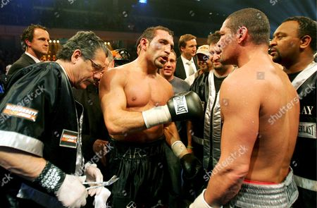 Stock Photo of Germany's Firat Arslan (c) Celebrates Winning the Wba Cruiserweight Title After Beating Title Holder Virgil Hill (2-r) of the Usa in Thier Wba Cruiserweight Title Boxing Fight at the Freiberger Arena in Dresden Germany 24 November 2007 Firat Arslan the Turkish-born German Won with Unanimous Decision with Scores of 118-110 116-113 and 117-111