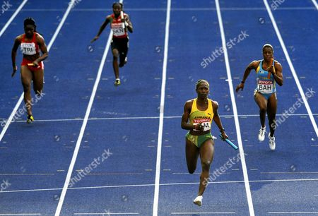 (l-r) Sarah Hackett of Trinidad and Tobago Victoria Hodge of Saint Kitts and Nevis Kerron Stewart of Jamaica and Debbie Ferguson-mckenzie of Bahamas Competes in the 4x100m Relay 1st Round at the 12th Iaaf World Championships in Athletics Berlin Germany 22 August 2009 Epa/rainer Jensen Germany Berlin