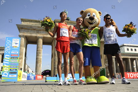 Winner of the 20km Walk Russian Valeriy Borchin (2-l) Pose with Chinese Hao Wang (l) Who Placed Second Mexican Eder Sanchez (r) Who Placed Third and the Mascot Berlino (2-r) at the 12th Iaaf World Championships in Athletics Berlin Germany 15 August 2009