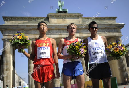 Winner of the 20km Walk Russian Valeriy Borchin (c) Pose with Chinese Hao Wang (l) Who Placed Second and Mexican Eder Sanchez Who Placed Third at the 12th Iaaf World Championships in Athletics Berlin Germany 15 August 2009