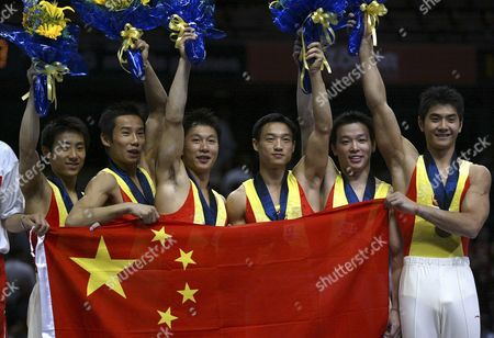 Chinese Team Members (from Left) Teng Haibin Xiao Qin Li Xiao Peng Yang Wei Huang Xu and Xing Aowei Pose with the Chinese Flag After Winning the Gold Medal in the Men's Team Finals at the World Gymnastics Championships in Anaheim California Tuesday 19 August 2003 Epa Photo/epa/mike Fiala United States Anaheim