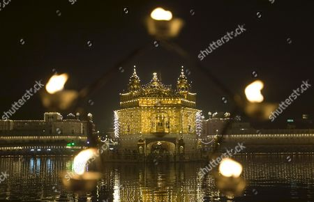 A View of the Illuminated Golden Temple the Most Sacred Place For Sikhs All Over the World Through a Lamp Stand On the Occasion of the Birth Anniversary of the First Sikh Guru Or Master Sri Guru Nanak Dev Ji in the Northern Indian City of Amritsar 13 November 2008 Guru Nanak Dev Ji is the Founder of Sikhism and the First of the Ten Gurus of the Sikhs