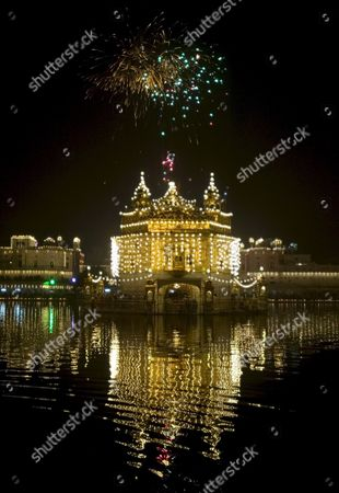 Fireworks Decorate the Skies Over the Illuminated Golden Temple the Most Sacred Place For Sikhs All Over the World On the Occasion of the Birth Anniversary of the First Sikh Guru Or Master Sri Guru Nanak Dev Ji in the Northern Indian City of Amritsar 13 November 2008 Guru Nanak Dev Ji is the Founder of Sikhism and the First of the Ten Gurus of the Sikhs