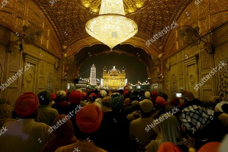 Sikh Devotees Visit to Pay Obeisance in the Pre Dawn Hours at the Golden Temple the Most Sacred Place For Sikhs All Over the World On the Occasion of the Birth Anniversary of the First Sikh Guru Or Master Sri Guru Nanak Dev Ji in the Northern Indian City of Amritsar 13 November 2008 Guru Nanak Dev Ji is the Founder of Sikhism and the First of the Ten Gurus of the Sikhs