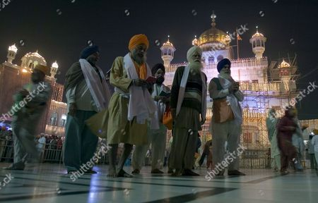 Sikh Devotees Offer Prayers in the Pre Dawn Hours at the Golden Temple the Most Sacred Place For Sikhs All Over the World On the Occasion of the Birth Anniversary of the First Sikh Guru Or Master Sri Guru Nanak Dev Ji in the Northern Indian City of Amritsar 13 November 2008 Guru Nanak Dev Ji is the Founder of Sikhism and the First of the Ten Gurus of the Sikhs