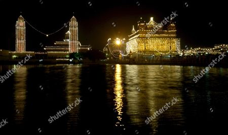 A General View of the Illuminated Golden Temple the Most Sacred Place For Sikhs All Over the World in the Pre Dawn Hours On the Occasion of the Birth Anniversary of the First Sikh Guru Or Master Sri Guru Nanak Dev Ji in the Northern Indian City of Amritsar 13 November 2008 Guru Nanak Dev Ji is the Founder of Sikhism and the First of the Ten Gurus of the Sikhs