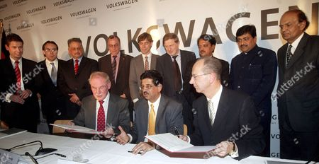 The Member of Board of Management of Volkswagen Ag Responsible For Finance Hans Dieter Potsch (r Sitting) Industry Secretary V K Jairath (c Sitting) and Chairman of Board of Management of Skoda Auto Detlef Wittig (l Sitting) During the Signing of the Agreement in New Delhi India On Wednesday 29 November 2006 Volkswagen Ag is to Build a New Production Plant in Pune in the Indian State of Maharashtra According to Present Plans the New Plant in the Chakan Industrial Park Near Pune Will Commence Producing Up to 110 000 Vehicles a Year As of 2009 with Investment Totaling Some 410 Million Euros Which is to Be Built On the 230 Hectare Site the Volkswagen Group with Its Headquarters in Wolfsburg is One of the World's Leading Vehicle Manufacturers and the Largest Car Producer in Europe