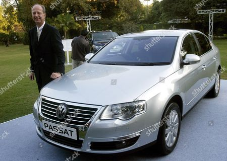 The Member of Board of Management of Volkswagen Ag Responsible For Finance Hans Dieter Potsch Poses with the New Passat Car After the Signing of the Agreement in New Delhi India On Wednesday 29 November 2006 German Automotive Group Volkswagen and the Western Indian State of Maharashtra Signed Wednesday an Investment Agreement For the Construction of a Vw Car Plant in What Was Termed the Biggest Single Investment in India Yet by a German Company Vw Put the Targeted Investment at 410 Million Euros (530 Million Dollars) For a Car Production Plant Near the City of Pune the Project Was Approved by Vws Supervisory Board Earlier This Month Vw Chief Financial Officer Hans Dieter Poetsch and the Head of the Companys Skoda Division Detlef Wittig Signed the Agreement Under Which Production is to Start Up in 2009 with the Plant to Produce 110 000 Cars Specially-designed For the India Market Annually