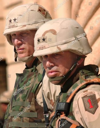 Major General Raymond T Odierno Commander of the 4th Infantry Division (id) (l) and Major General John R S Batiste Commander of the 1st Id (r) Watch a Transfer of Authority Ceremony in Tikrit Iraq On Tuesday 16 March 2004 the 1st Id Officially Took Control of the 4th Id's Area of Operations Today Which Encompasses Most of the Sunni Triangle