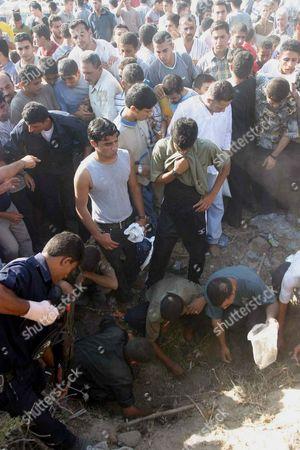 Palestinians Youths And Policemen Search Near The Car Of Fared Mayat Abdalah Aqel In Salah
