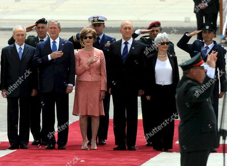 Israeli Prime Minister Ehud Olmert and His Wife Aliza Olmert (r) Stand Alongside Us President George Bush and Us First Lady Laura Bush [c] During the Listening to the Us Anthem at Ben Gurion Airport On 14 May 2008 Bush is in Israel to Help Celebrate Its 60th Anniversary and Will Travel On to Other Middle East Countrie On Extreme Left is Israeli President Shimon Peres