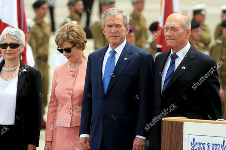 Israeli Prime Minister Ehud Olmert [r]and Aliza Olmert (l] As They and Us President George Bush and Us First Lady Laura Bush [c] Pause During the Playing of National Anthem's Following Bush's Arrival in Ben Guurion Airport On 14 May 2008 Bush is in Israel to Help Celebrate Its 60th Anniversary and Will Travel On to Other Middle East Countrie