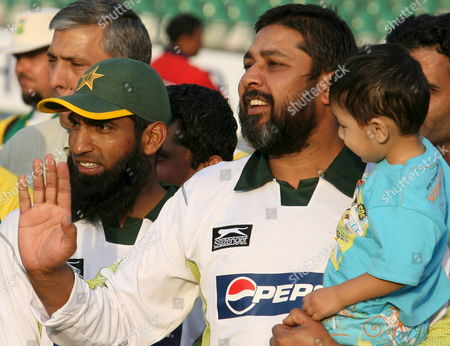 Pakistani Batsman Inzamam-ul-haq (r) Who Made His Final Test Appearance at a Ground where He Made His Debut in 1990 Holds His Son After the Second Test Cricket Match Between Pakistan and South Africa at Gaddafi Cricket Stadium in Lahore Pakistan 12 October 2007