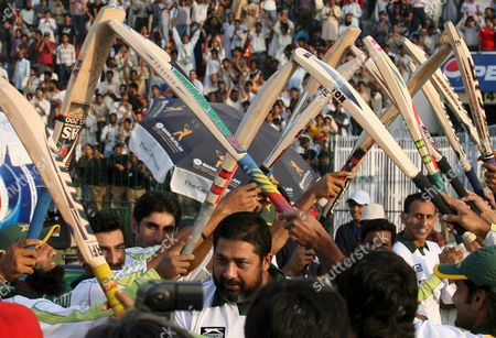 Pakistani Cricketers Pay Respect to Their Team Mate Inzamam-ul-haq (c) Who Leaves After Making His Final Test Appearance at a Ground where He Made His Debut in 1990 After the Second Test Cricket Match Between Pakistan and South Africa at Gaddafi Cricket Stadium in Lahore Pakistan 12 October 2007