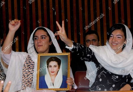 Daughters of Benazir Bhutto and Asif Ali Zardari Bakhtawar (l) and Asifa Hold a Picture of Their Murdered Mother As They Celebrate the Election of Asif Ali Zardari As the Countriy's President 06 September 2008 in Islamabad Parliament the Widower of Murdered Benazir Bhutto Won an Overwhelming Majority of the Votes According to the Unofficial Result out of 702 Asif Ali Zardari Secured 479 Votes of Which He Got 281 From Parliament 22 From Punjab 64 From Sindh 59 From Balochistan and 56 From Nwfp