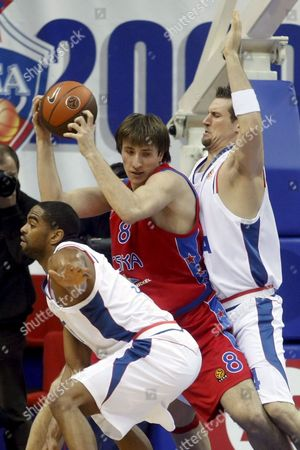 Matjaz Smodis (c) of Cska (moscow) Attacks As Alan Anderson (l) and Jared Homan (r) of Cibona (zagreb Croatia) Try to Stop Him During Their Euroleague Top 16 Basketball Match in Moscow Russia 04 February 2009