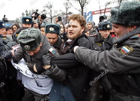 Police Officers Scuffle with Protesters During an Opposition Rally in Moscow Russia 20 March 2010 According to Local Media Reports Thousands of People Throughout Russia Protested Against Prime Minister Putin's Government and the Fall of Living Standards Since the Economic Crisis Some 50 Rallies Were Thus Organized by a Coalition of Opposition Groups Which Declared a National 'Day of Anger' on 20 March Moscow Protesters Demanded the Discharge of Moscow Mayor Yury Luzhkov They Shouted the Slogans: 'Moscow Without Luzhkov' 'Russia Without Putin' Russian Federation Moscow