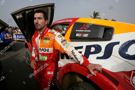 Driver Luc Alphand From France Stands Next to His Vehicle After Reaching Dakar Senegal Saturday 20 January 2007 Driver Alphand and Navigator Gilles Picard Are in Second Place Overall Going Into Sunday's Final Stage of the Race