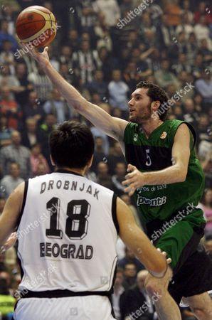 Rodolfo Fernandez (r) of Joventut Badalona Scores Past Predrag Drobnjak of Partizan Belgrade During Their Final 16 Euroleague Basketball Match in Belgrade On Thursday 01 March 2007