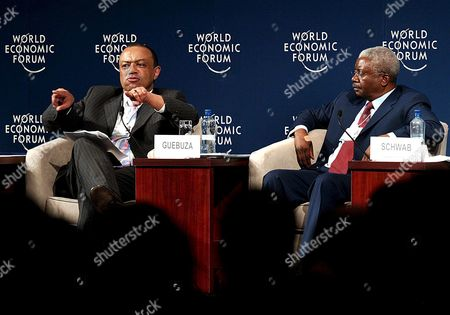 Paul Boateng High Commissioner Designate of the United Kingdom to South Africa (l) Speaks As Armando Emilio Guebuza President of Mozambique (r) Looks On During the Opening Plenary Session Called the 'G8 and Africa' On the 1st Day of the Africa Economic Summit in Cape Town South Africa Wednesday 01 June 2005 the World Economic Forums Africa Economic Summit Has Opened with Top Business Leaders Calling On Their Colleagues to Spearhead Moves For Change in Africa the Three Co-chairs of the Summit Urged Captains of Industry to Join Governments and Organizations in Grasping the Current Global 'Will to Action' in Africa