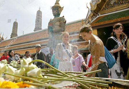 Miss Universe 2005 Contestants Elena Ralph of Israel (c) Mary Gormley of Ireland (r) and Brooke Johnson of United Kingdom (l) Pay Respect to Buddha with Lotus Candle and Joss Stick During a Visit to the Temple of the Emerald Buddha Eastern Section of the Royal Palace Bangkok Thailand Wednesday 11 May 2005 Around 82 Beauty Queens Come to Compete For the Most Coveted Beauty Title of the World in Thailand On Tuesday 31 May