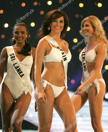 Miss Universe 2005 Contestant Miss Spain Veronica Hidalgo C with Miss Sri Lanka Rozanne Diasz L and Miss Switzerland Fiona Hefti R in Their Swimwear During the First Round of Judging in the Miss Universe Competition Held in Bangkok Thailand On Thursday 26 May 2005 Yong Women Representing 81 Nations Are Competing For the Miss Universe 2005 Title Held by 2004 Winner Australian Jennifer Hawkins the Finals of the Event Are to Be Held On 31 May in Bangkok