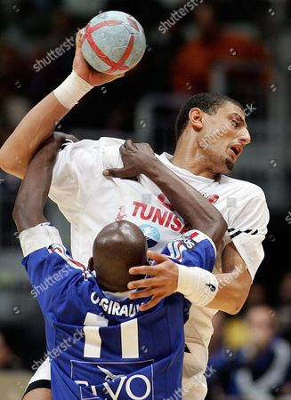 Wissem Hmam (r) of Tunisia Tries to Score Against Olivier Girault (l) of France During Their Men's 19th World Handball Championship 3rd Place Match in Rades Tunisia Sunday 06 February 2005