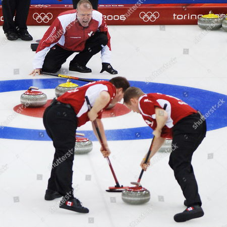Team Canada Skip Russ Howard (top) Yells Orders to His Teammates Gushue Nichols (lc) and Mike Adam (r) During Their Curling Round Robin Event Against Usa at Turin 2006 Winter Olympic Games Monday 20 February 2006