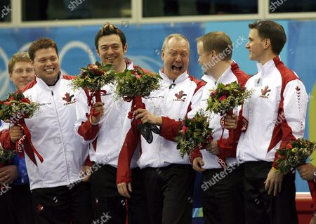 From L-r Mike Adam Jamie Korab Russ Howard Mark Nichols and Brad Gushue of Canada Celebrate On Podium of Curling Men's Gold Medal Game Canada Vs Finland at Turin 2006 Winter Olympic Games Friday 24 February 2006 Canada Won Gold Followed by Second Placed Finland and Third Placed Usa