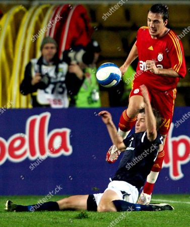 Galatasaray's Volkan Yaman (r) Fights For Ball Against Helsingborg's Olafur Skulason During Their Uefa Cup Group H Match at Ali Sami Yen Stadium in Istanbul Turkey On 08 November 2007