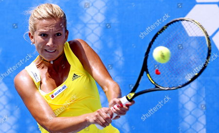 Marta Domachowska of Poland Returns the Ball to Lucie Hradecka of Czech Republic During Their Quarter Final Tennis Match at Istanbul Cup 2009 Wta Tournament at Enka Arena in Istanbul Turkey 31 July 2009