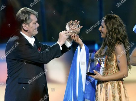 Ukrainian President Viktor Yushchenko Hands to Greece Singer Helena Paparizou Her Trophies As Winner of Eurovision Song Contest in Kiev Saturday 21 May 2005 Paparizou Won with the Song 'My Number One'