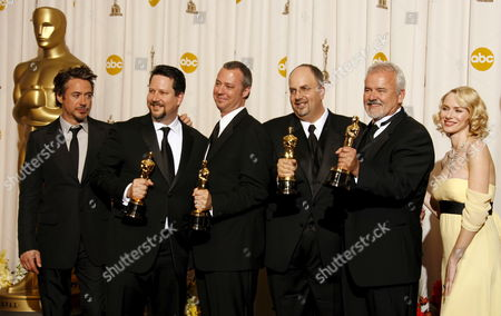 Stock Picture of Australian Actor Naomi Watts (r) and Us Actor Robert Downey Jr (l) Pose After Presenting (2nd L to 2nd R) John Knoll Hal Hickel Charles Gibson and Allen Hall Their Oscars For Achievement in Visual Effects For 'Pirates of the Caribben: Dead Man's Chest' at the 79th Annual Academy Awards at the Kodak Theatre in Hollywood California Sunday 25 February 2007