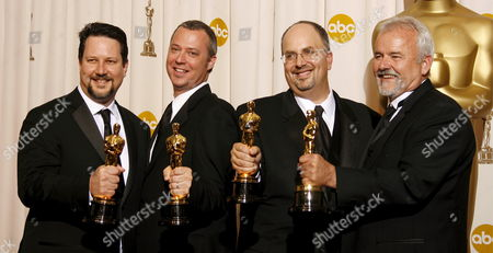 Stock Image of (l-r) John Knoll Hal Hickel Charles Gibson and Allen Hall Hold Their Oscars For Achievement in Visual Effects For 'Pirates of the Caribben: Dead Man's Chest' at the 79th Annual Academy Awards at the Kodak Theatre in Hollywood California Sunday 25 February 2007