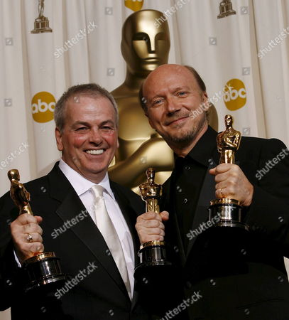 Bobby Moresco (l) and Paul Haggis (r) Hold Their Oscars For 'Original Screenplay' For the Film 'Crash' at the 78th Annual Academy Awards in Hollywood California Sunday 05 March 2006