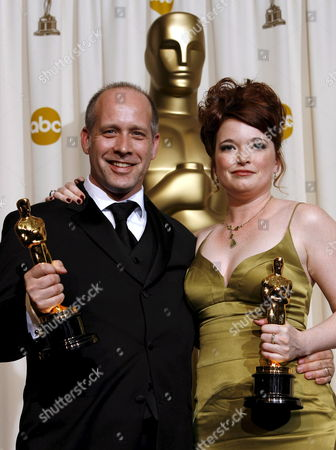 Stock Picture of Corinne Marrinan (r) and Eric Simonson (l) Pose with Their Oscars For 'Best Documentary Short Subject' For the Film 'A Note of Triumph: the Golden Age of Norman Corwin' at the 78th Annual Academy Awards in Hollywood California Sunday 05 March 2006