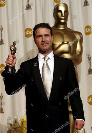 Dion Beebe Holds Up His Oscar For 'Achievement in Cinematography' For the Film 'Memoirs of a Geisha' at the 78th Annual Academy Awards in Hollywood California Sunday 05 March 2006