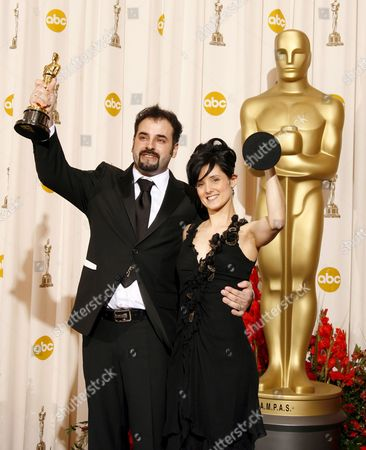 Stock Image of David Marti and Montse Rib? Hold Up Their Oscars For Achievement in Makeup For 'Pan's Labyrinth' at the 79th Annual Academy Awards at the Kodak Theatre in Hollywood California Sunday 25 February 2007