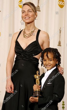 Torill Kove Stands with Presenter Jaden Smith As He Holds Her Oscar For Best Animated Short Film For 'The Danish Poet' at the 79th Annual Academy Awards at the Kodak Theatre in Hollywood California Sunday 25 February 2007