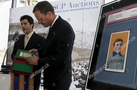 Stock Picture of The T206 Honus Wagner Baseball Card is Displayed by Auction Company Officials Dan Imler (l) and David Kohler (r) at a Dodger Stadium Press Conference Announcing the Sale of the Card in Los Angeles California Tuesday 27 February 2007 the T206 Honus Wagner Card Recognized by Collectors As the Most Famous and Valuable Baseball Card in Existence Was Bought by a Private Collector in California For a Record $2 35 Million Dollars Previous Owners of the Card Include Wal-mart and Hockey Great Wayne Gretzky