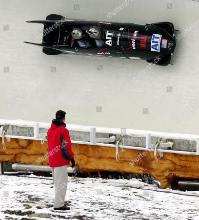 The Usa-1 Sled with Only Pilot Todd Hays and Pavle Jovanovic On Board Take a Curve After Crashing and Ejecting Team Members Steve Mesler and Garrett Hines Early in the Course During the Final Heat of the 2005/06 Fibt Ait Men's 4-man Bobsleigh World Cup in Lake Placid New York Sunday 20 November 2005 Hays Was Able to Right the Sled and Finish the Course But the Loss of Two Team Members Along the Course Caused a Disqualification
