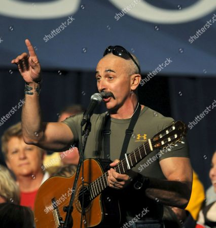 Stock Picture of Country Singer Aaron Tippin Warms Up the Crowd Waiting to See Republican Vice Presidential Hopeful Governor Sarah Palin Speak at a Campaign Rally in Des Moines Iowa Usa 25 October 2008