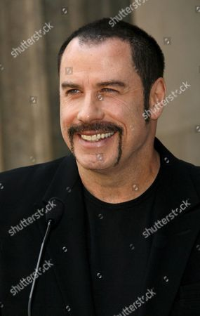 Us Actor John Travolta Watches the Festivities After Introducing Us Cinema and Television Mogul Michael D Eisner During Ceremony Honoring Eisner with a Star On the Hollywood Walk of Fame in Los Angeles California Usa 25 April 2008 Eisner Former Executive at Abc and Later As Head of Paramount Pictures and Ceo of the Walt Disney Company Helped Launch Travolta's Career with Television Shows 'Welcome Back Kotter' and Films 'Saturday Night Fever' and 'Grease'