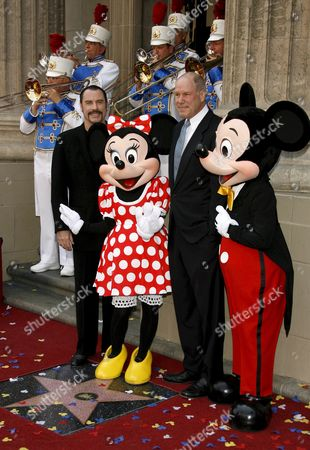 Us Actor John Travolta (l) and Us Cinema and Television Mogul Michael D Eisner (r) Pose with Minnie and Mickey Mouse During Ceremony Honoring Eisner with a Star On the Hollywood Walk of Fame in Los Angeles California Usa 25 April 2008 Eisner Former Executive at Abc and Later As Head of Paramount Pictures and Ceo of the Walt Disney Company Helped Launch Travolta's Career with Television Shows 'Welcome Back Kotter' and Films 'Saturday Night Fever' and 'Grease'